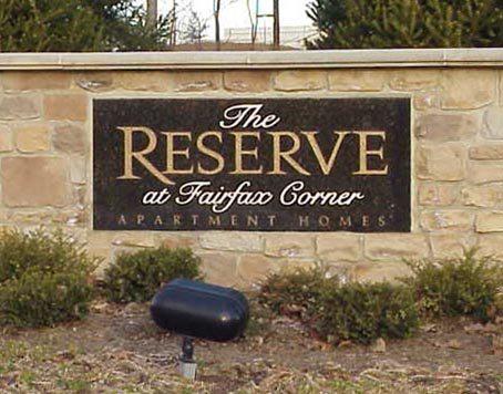 The Reserve at Fairfax Corner sign by Kline Memorials